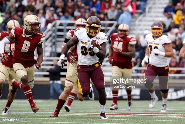 Boston College defensive back William Harris draws a bead on Central Michigan running back Kumehnnu Gwilly during a game between the Boston College...