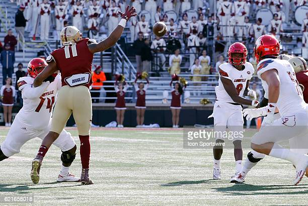 Boston College defensive end Wyatt Ray can not stop the pass form Louisville Cardinals quarterback Lamar Jackson to Louisville Cardinals tight end...