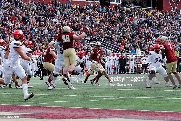 Boston College defensive tackle Ray Smith is helpless as the pass form Louisville Cardinals quarterback Lamar Jackson finds Louisville Cardinals...