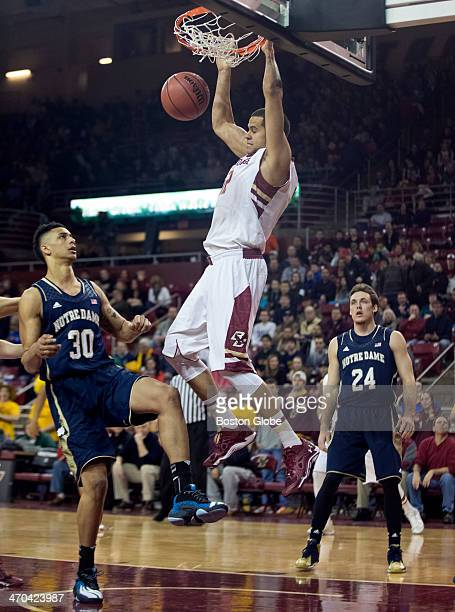 Boston College Eagle Ryan Anderson slam dunks in between Notre Dame Fighting Irish player Zach Auguste and Pat Connaughton during first half action...
