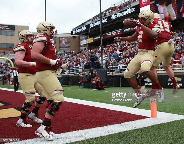 Boston College Eagles AJ Dillon celebrates his 14 yard rushing touchdown with teammate Ben Glines against Central Michigan Chippewas during the first...