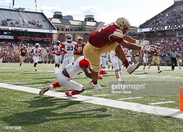 Boston College Eagles' AJ Dillon is forced out of bounds by Richmond Spiders' Trent Williams during the first quarter The Boston College Eagles has...