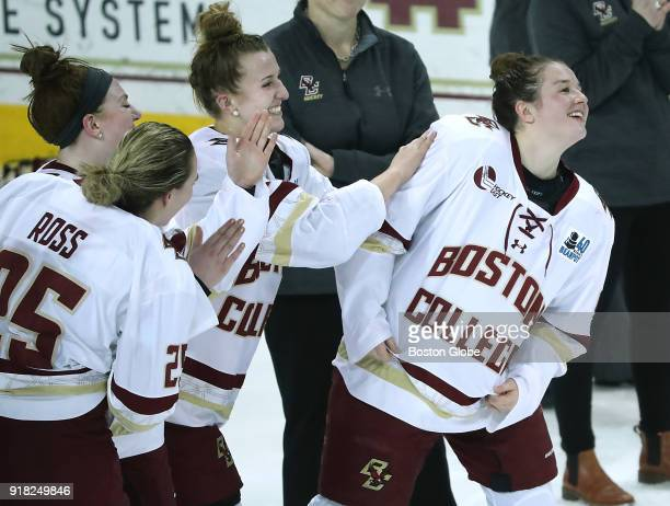 Boston College Eagles' Daryl Watts is patted on the back as she was named MVP of the Beanpot Tournament after the team defeated Boston University 43...