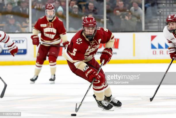 Boston College Eagles defenseman Casey Fitzgerald carries the puck in the neutral zone during a Hockey East semifinal game between the Boston College...