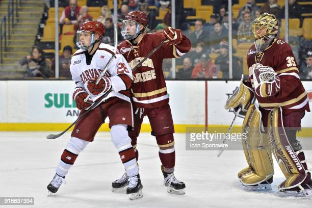Boston College Eagles defenseman Connor Moore tries to wrap up Harvard Crimson forward Henry Bowlby During the Boston College Eagles game against the...