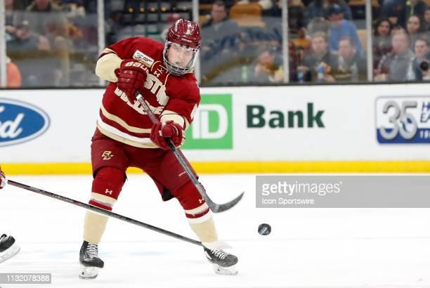 Boston College Eagles defenseman Jesper Mattila dumps the puck in the zone during a Hockey East semifinal game between the Boston College Eagles and...