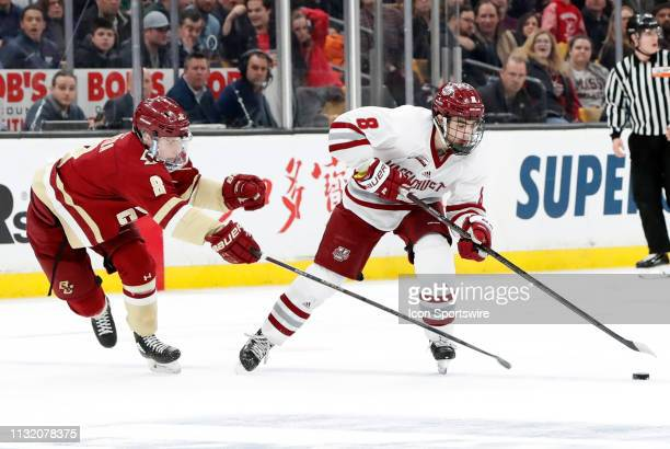 Boston College Eagles defenseman Jesper Mattila pressures UMASS Minutemen forward Bobby Trivigno during a Hockey East semifinal game between the...