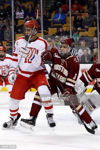 Boston College Eagles defenseman Luke McInnis tries to get position on Boston University Terriers forward Jordan Greenway during a Hockey East...