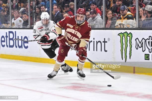 Boston College Eagles defenseman Luke McInnis tries to keep the puck away from Northeastern Huskies forward Liam Pecararo . During the Hockey East...