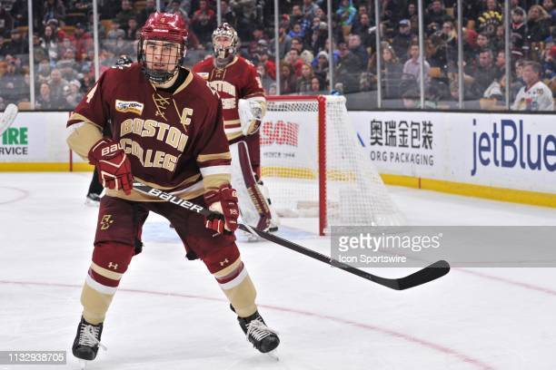 Boston College Eagles defenseman Michael Kim keeps close eye on the puck as it enters his teams zone. During the Hockey East Championship game...