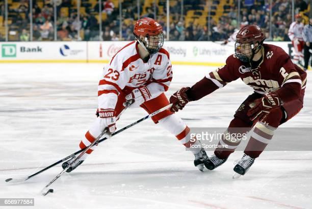 Boston College Eagles defenseman Scott Savage pressures Boston University Terriers forward Jakob Forsbacka Karlsson during a Hockey East semifinal...
