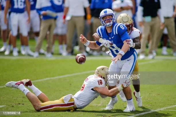 Boston College Eagles defensive back Deon Jones (5 forces Duke Blue Devils quarterback Chase Brice (8 to fumble as Boston College Eagles defensive...