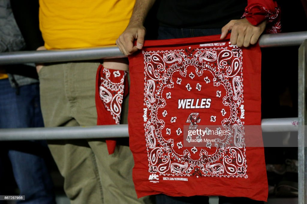 Boston College Eagles fan holds a red bandana to honor Boston College alumni Welles Crowther during the first quarter of the game between the Eagles and the Florida State Seminoles at Alumni Stadium on October 27, 2017 in Chestnut Hill, Massachusetts. Crowther was a Boston College alumni who lost his life after saving at least 10 people during the 9/11 terrorist attacks.