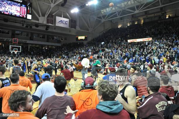 HILL MA Boston College Eagles fans storm the court after the 89 to 84 upset of Duke During the Boston College Eagles game against the Duke Blue...
