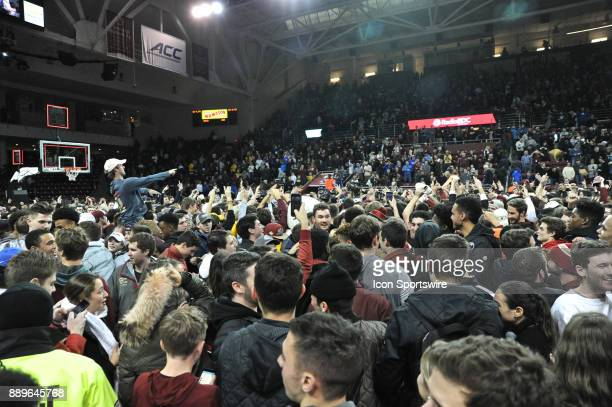 HILL MA Boston College Eagles fans storm the court after the 89 to 84 victory During the Boston College Eagles game against the Duke Blue Devils on...