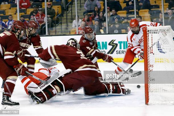Boston College Eagles forward Austin Cangelosi does enough to stop Boston University Terriers forward Jakob Forsbacka Karlsson from putting it in the...