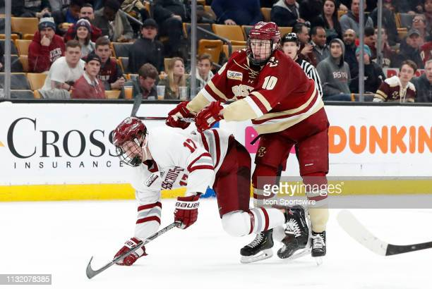Boston College Eagles forward Christopher Brown cross checks UMASS Minutemen forward Philip Lagunov during a Hockey East semifinal game between the...