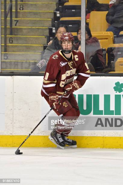 Boston College Eagles forward Christopher Brown looks across the ice for an open teammate During the Boston College Eagles game against the Harvard...