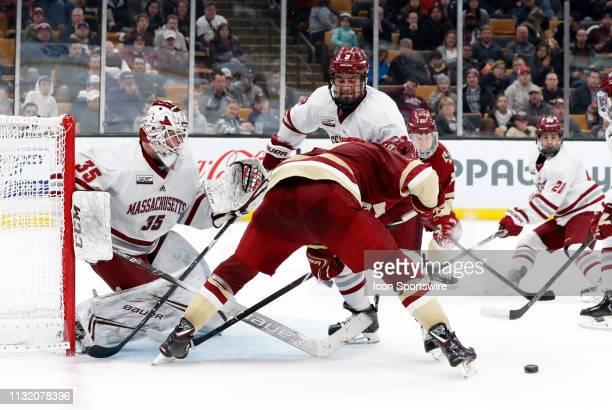 Boston College Eagles forward David Cotton looks for the rebound off UMASS Minutemen goalie Filip Lindberg during a Hockey East semifinal game...