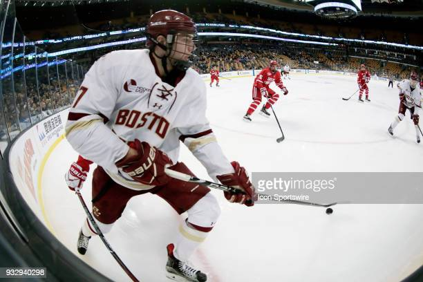 Boston College Eagles forward Graham McPhee looks to the point during a Hockey East semifinal between the Boston College Eagles and the Boston...