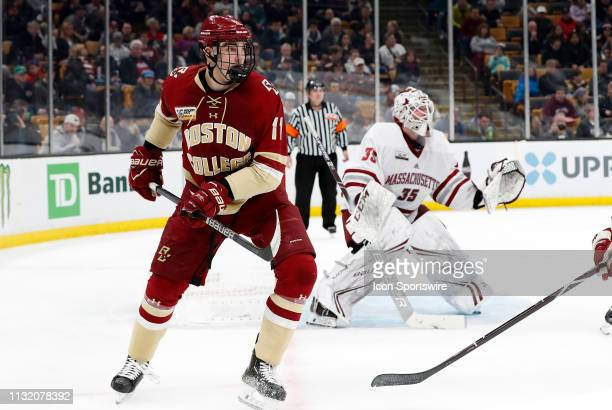 Boston College Eagles forward Jack McBain looks for the pass on the power play during a Hockey East semifinal game between the Boston College Eagles...