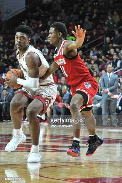 Boston College Eagles forward Jairus Hamilton tries to get past North Carolina State Wolfpack guard Markell Johnson with the ball During the Boston...
