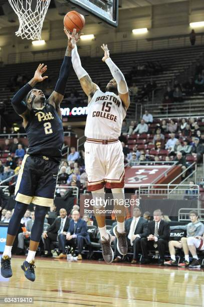 Boston College Eagles forward Mo Jeffers goes up over Pittsburgh Panthers forward Michael Young for the basket During the Boston College Eagles game...