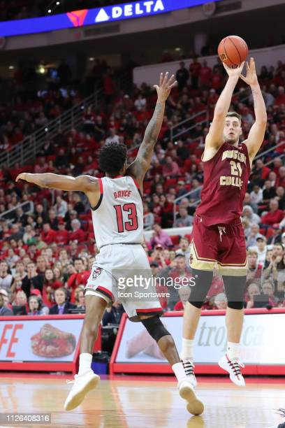 Boston College Eagles forward Nik Popovic goes for the point while North Carolina State Wolfpack guard CJ Bryce tries to stop him during the 2nd half...