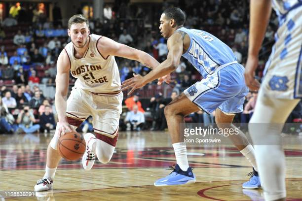 Boston College Eagles forward Nik Popovic tries to drive past North Carolina Tar Heels forward Garrison Brooks with the ball During the Boston...