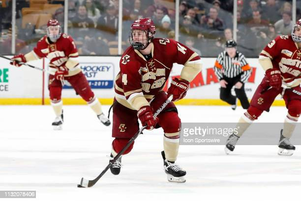Boston College Eagles forward Zach Walker skates with the puck during a Hockey East semifinal game between the Boston College Eagles and the UMASS...