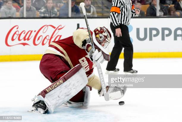 Boston College Eagles goaltender Joseph Woll covers the puck during a Hockey East semifinal game between the Boston College Eagles and the UMASS...