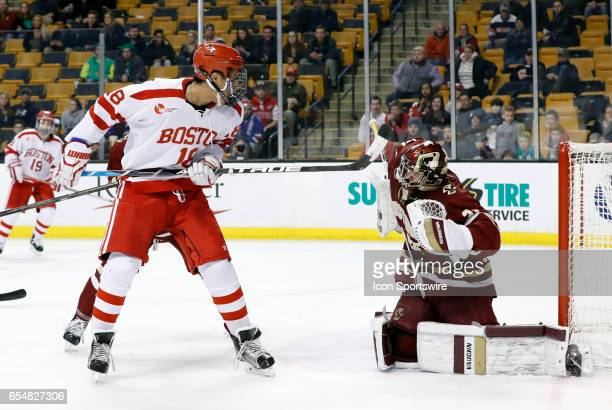Boston College Eagles goaltender Joseph Woll makes a save with Boston University Terriers forward Jordan Greenway in front during a Hockey East...