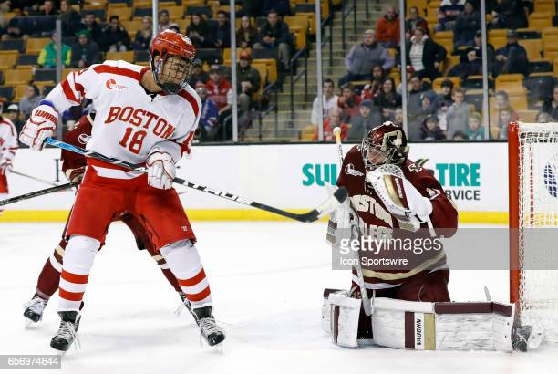 Boston College Eagles goaltender Joseph Woll makes the save with Boston University Terriers forward Jordan Greenway screening in front during a...