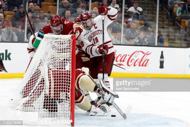 Boston College Eagles goaltender Joseph Woll pounces on the puck with UMASS Minutemen forward Niko Hildenbrand in the crease during a Hockey East...