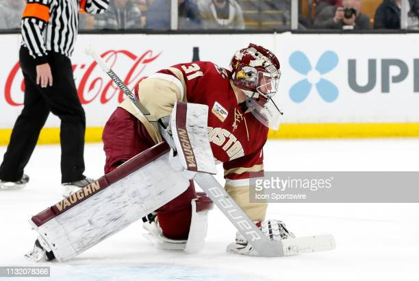 Boston College Eagles goaltender Joseph Woll stops play during a Hockey East semifinal game between the Boston College Eagles and the UMASS Minutemen...