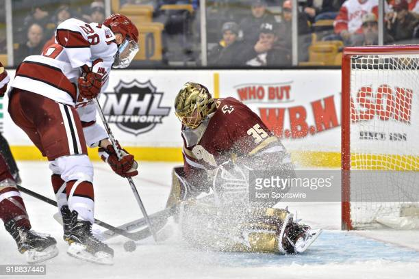 Boston College Eagles goaltender Ryan Edquist makes a nice stop During the Boston College Eagles game against the Harvard University Crimson at TD...