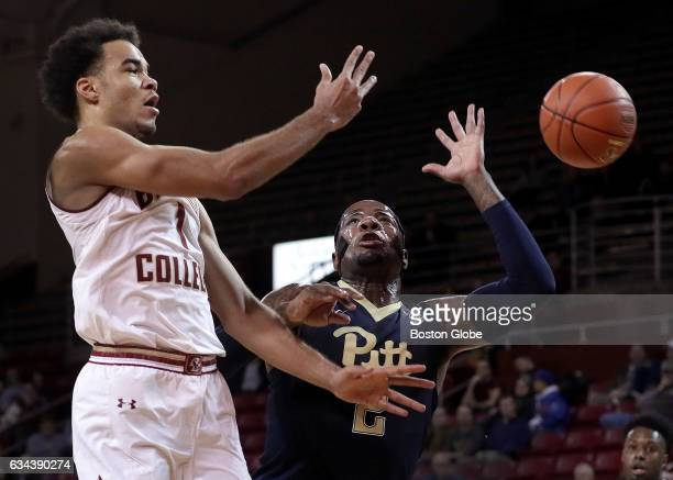 Boston College Eagles guard Jerome Robinson dishes off a pass as Pittsburgh Panthers forward Michael Young closes in during the first half Boston...