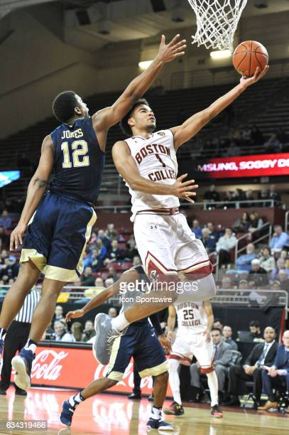 Boston College Eagles guard Jerome Robinson goes up over Pittsburgh Panthers guard Chris Jones for the basket During the Boston College Eagles game...