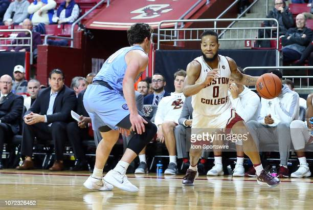 Boston College Eagles guard Ky Bowman defended by Columbia Lions guard Quinton Adlesh during a college basketball game between Columbia Lions and...