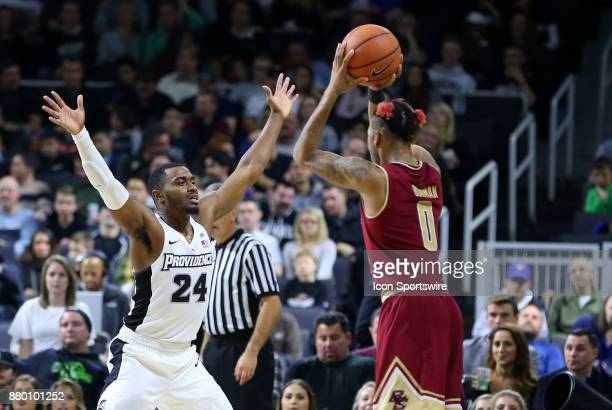 Boston College Eagles guard Ky Bowman defended by Providence Friars guard Kyron Cartwright during a college basketball game between Boston College...