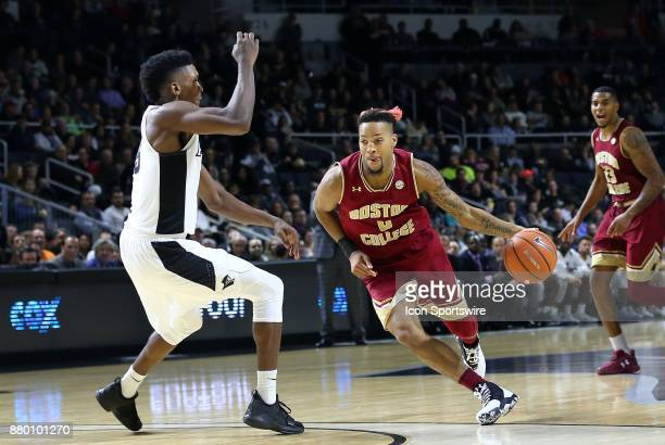 Boston College Eagles guard Ky Bowman drives to the basket defended by Providence Friars forward Rodney Bullock during a college basketball game...