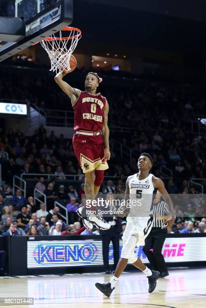 Boston College Eagles guard Ky Bowman dunks the ball as Providence Friars forward Rodney Bullock look on during a college basketball game between...