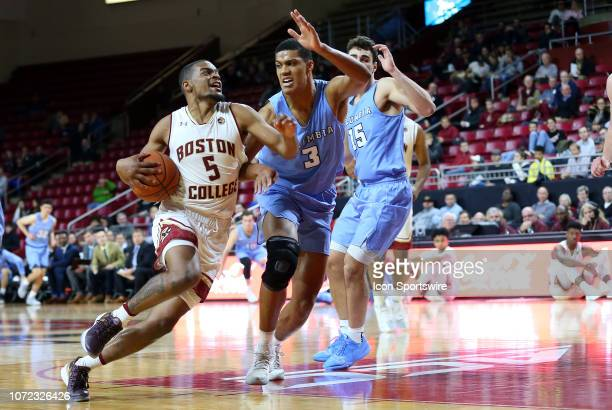 Boston College Eagles guard Wynston Tabbs drives past Columbia Lions forward Patrick Tape during a college basketball game between Columbia Lions and...