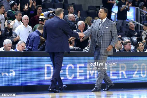 Boston College Eagles head coach Jim Christian and Providence Friars head coach Ed Cooley shakes hands at the conclusion of a college basketball game...