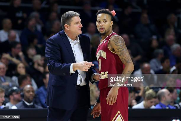 Boston College Eagles head coach Jim Christian speaks with Boston College Eagles guard Ky Bowman during a college basketball game between Boston...
