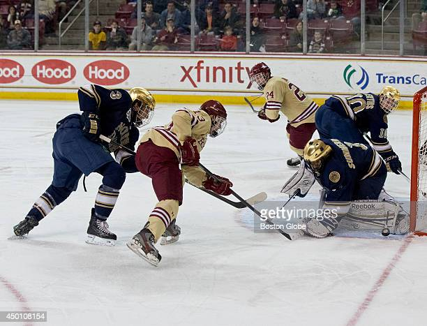 Boston College Eagles Johnny Gaudreau's shot going wide of Notre Dame Fighting Irish goalie Steven Summerhays and the net during third period action...