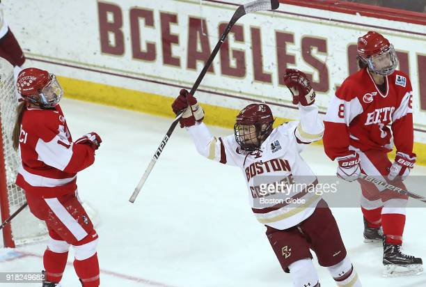Boston College Eagles' Kate Annese celebrates her goal in between Boston University Terries' Breanna Scarpaci left and Deziray De Sousa during the...