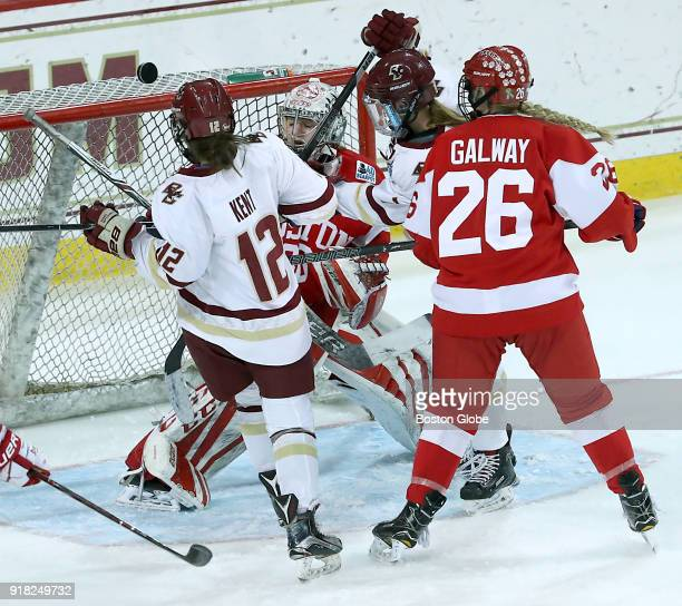 Boston College Eagles' Kenzie Kent left and Maegan Beres are denied a goal by Boston University Terriers goalie Corinne Schroeder during the second...