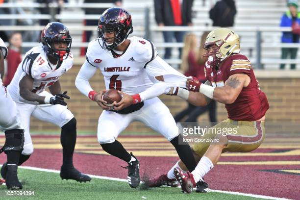 Boston College Eagles linebacker Isaiah McDuffie tries to drag down Louisville Cardinals quarterback Jordan Travis for a safety During the Boston...