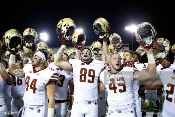 Boston College Eagles players celebrate after a win against the Northern Illinois Huskies at Huskie Stadium on September 1 2017 in DeKalb Illinois...